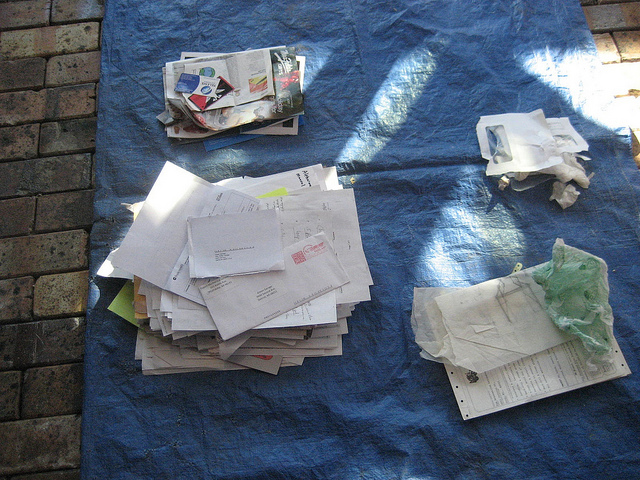 Paper sorted into piles